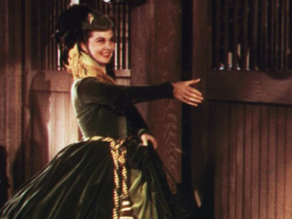 <strong>Window Dressing:</strong> In 1939's <em>Gone With the Wind</em>, Scarlett O'Hara (Vivien Leigh) dresses to impress Rhett Butler (Clark Gable) so he'll help her pay off back taxes on the family plantation.