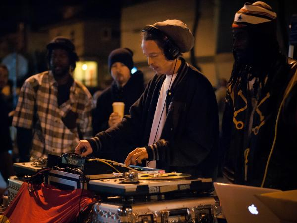 A DJ plays for a crowded street at Oakland's Art Murmur celebration in February.