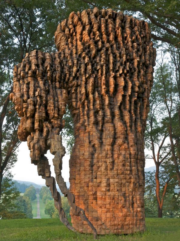 """<em>Luba</em>, 2010. Cedar, graphite, bronze. 212"""" x 139"""" x 88""""."""