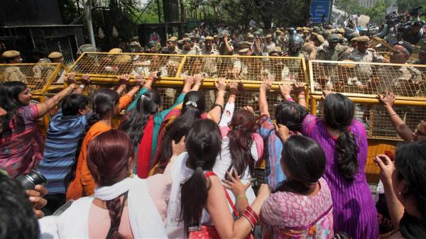 Protesters attempt to break through a barricade outside Delhi police headquarters on Saturday during a protest over the rape of a 5-year-old girl in New Delhi, India.