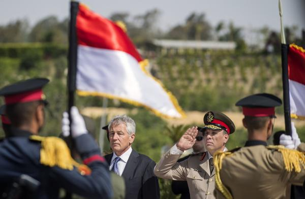 U.S. Secretary of Defense Chuck Hagel stands with an Egyptian army official as he salutes before laying a wreath at the Tomb of the Unknown Soldier on Wednesday in Cairo, Egypt.