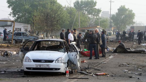 Investigators work at the site of a bombing in the Dagestan capital, Makhachkala, last year. The blasts near a police post killed at least 15 people. The southern Russian republic has seen persistent violence.