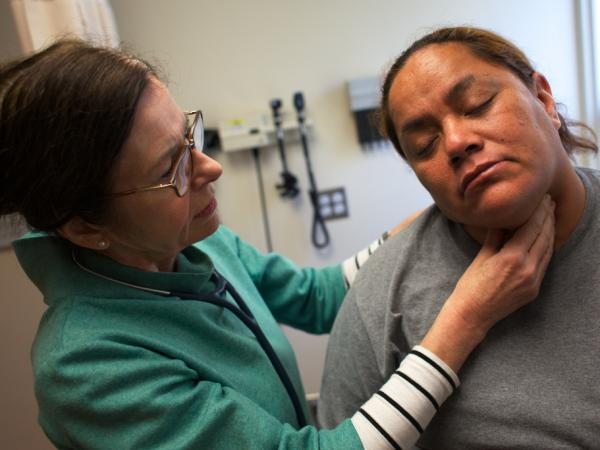 Nurse Practioner Tina Clark examines Anastacia Casperson at the Glide Health Clinic in San Francisco.