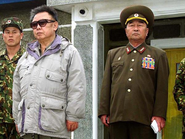 Demoted Defense Chief Kim Kyok Sik (right) with the late North Korean leader Kim Jong Il in a 2007 file photo released by Korean Central News Agency.