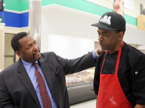 Wendell Pierce, the actor and co-owner of Sterling Farms grocery store, chats with Dwight Henry, who will be making doughnuts and buttermilk drops in the store.