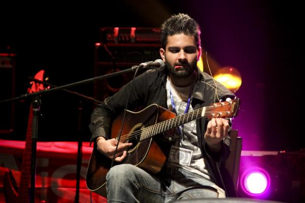 The 23-year-old, Colorado-born Omar (shown here performing an acoustic set with a member of District Unknown) says he was pleasantly surprised by the vibrant music scene he found when he landed in Kabul last year.