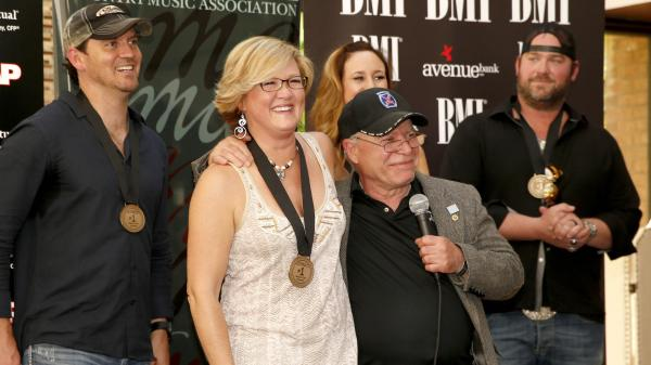 "On Monday, the team behind Lee Brice's ""I Drive Your Truck"" gathered in Nashville to celebrate the song's reaching No. 1 on the <em>Billboard</em> Country Airplay chart. From left: co-songwriters Jimmy Yeary, Connie Harrington and Jessi Alexander, military father Paul Monti and singer Lee Brice."