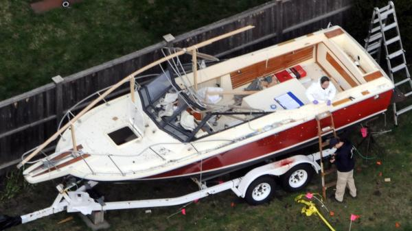 April 20 in Watertown, Mass.: Investigators work in and around the boat in which Boston bombings suspect Dzhokhar Tsarnaev was found hiding.