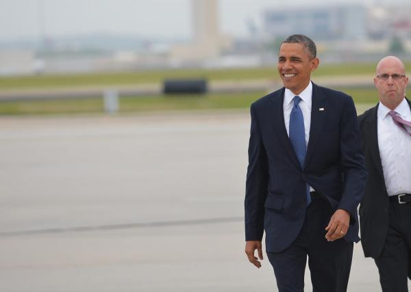 President Obama walks across the tarmac to greet well-wishers on Sunday upon his arrival in Atlanta, Ga., where he will attend the commencement at Morehouse College.