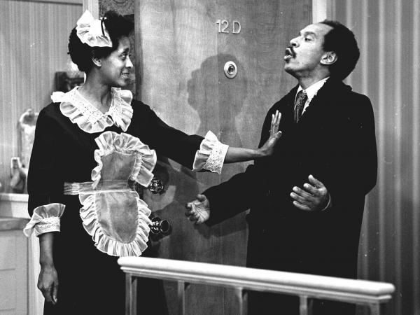 Actress Marla Gibbs (as maid Florence Johnston) and actor Sherman Hemsley (as her boss, George Jefferson), appear in an episode of <em>The Jeffersons</em>.