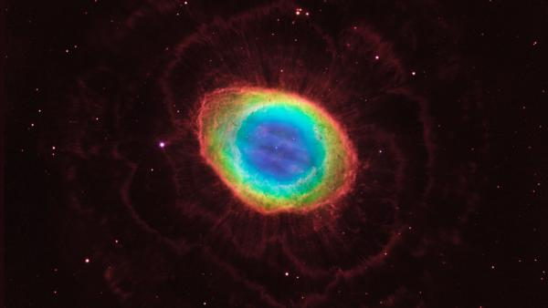 The famous Ring Nebula is shown here in striking detail, in a composite image made from images from NASA's Hubble Space Telescope and infrared data from telescopes on Earth.