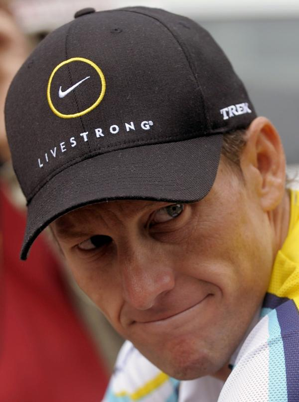 Lance Armstrong in 2009, wearing some of Nike's Livestrong apparel. Nike will stop manufacturing that line after the 2013 holiday season. And it is ending its support of the Livestrong charity.