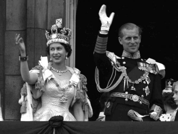 <strong>Cheers For The Queen ... And The Chicken:</strong> Britain's Queen Elizabeth II and Prince Philip, Duke of Edinburgh, greet supporters from the balcony at Buckingham Palace, following her coronation, June 2, 1953.