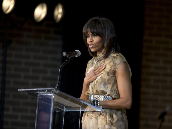 The first lady was confronted by a heckler at a private event in Washington on Tuesday.