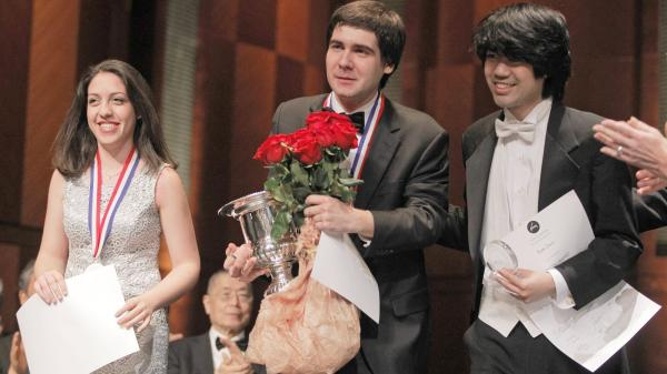 Cliburn medalists Beatrice Rana, second place winner; Vadym Kholodenko, first place winner; and Sean Chen, third place winner, receive applause from the audience at the final awards ceremony at the 14th Van Cliburn International Piano Competition on Sunday.