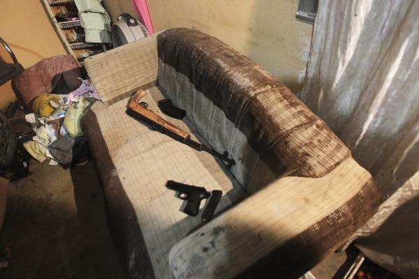 Confiscated weapons lie on a couch after the arrest of several members of the 18th Street gang after a shootout with police and military during an anti-drug operation in San Pedro Sula, on March 27. San Pedro Sula, the country's second-largest city after the capital, Tegucigalpa, has a homicide rate of 169 per 100,000 people and was named the world's most violent city for a second year in a row.