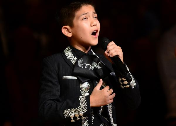 Sebastien de la Cruz, known as San Antonio's Little Mariachi, sings the national anthem before the start of Game 4 of the NBA finals on Thursday.