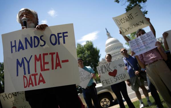 Protesters gather outside the U.S. Capitol on Thursday to rally against the National Security Agency's recently detailed surveillance programs.