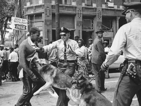 A 17-year-old Civil Rights demonstrator is attacked by a police dog in Birmingham, Ala., on May 3, 1963. This image led the front page of the next day's <em>New York Times</em>.