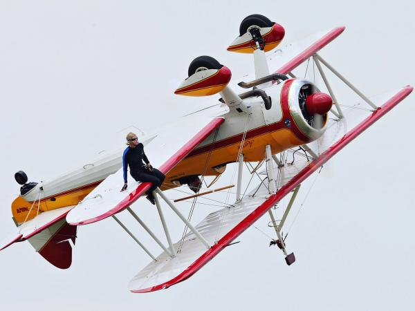 Wing walker Jane Wicker performs at the Vectren Air Show just before crashing on Saturday. She and pilot Charlie Schwenker were killed.