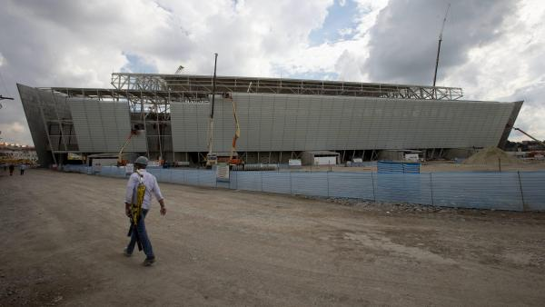 Construction is underway on the Itaquerao stadium in Sao Paulo, shown here June 12. The stadium will be the venue for the opening ceremony and game of the 2014 FIFA World Cup in Brazil, and many migrants are among the laborers working on the project.