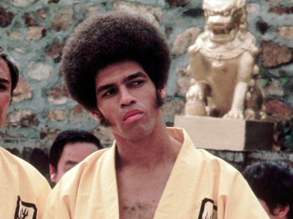 This 1973 photo released by Warner Bros. Entertainment shows Jim Kelly as Williams in a scene from <em>Enter the Dragon</em>. Kelly, who played a glib American martial artist in the movie, died Saturday of cancer at his home in San Diego. He was 67.