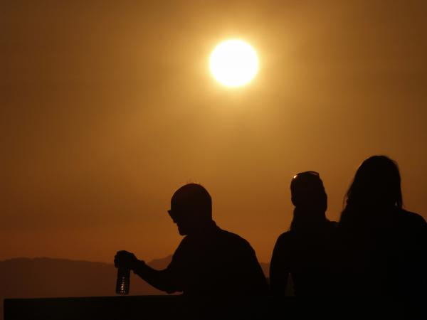 Oh, baby it's hot: The sun shines down on people standing atop the roof of the Griffith Observatory in Los Angeles, one of the cities in the grips of a dangerous heat wave.