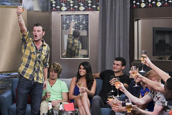 Houseguest Judd makes a toast during the season premiere of <em>Big Brother</em>.