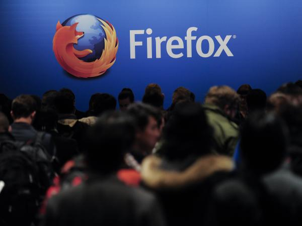 People wait to attend a Mozilla press conference in Barcelona, Spain, in February. Mozilla's Firefox and other Web browsers allow users to opt out of third-party tracking cookies.