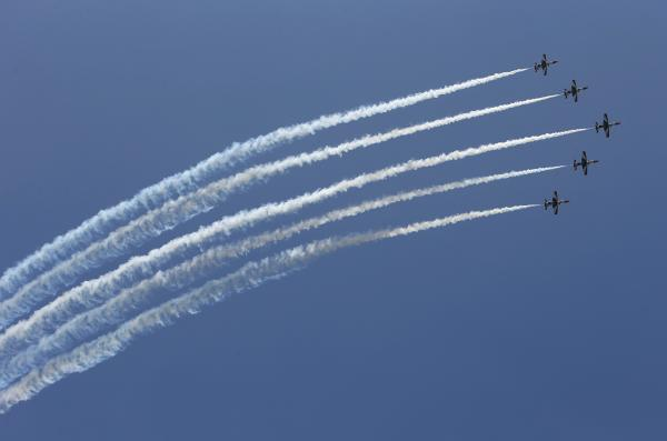 Egyptian military jets fly in formation over Cairo as Mansour is sworn in. The military says Mansour will serve only until new elections can be held.