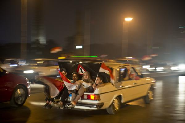 An Egyptian family rejoices in Cairo after a broadcast Wednesday confirming that the army has forced Morsi out of office.
