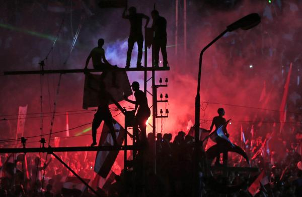 Anti-government protesters celebrate Morsi's ouster outside the presidential palace in Cairo.
