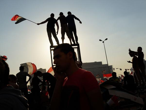 People dance and cheer in Cairo's Tahrir Square on July 4, the day after former Egyptian President Mohammed Morsi was ousted from power.