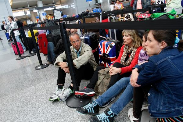 From left, Alphonse Roig, his wife Christine Roig, and daughters Nanine and Lana, wait for the British Airways counter to reopen. The family was trying to make it home to France.