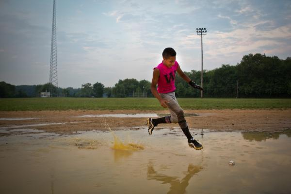 A.J. Ramos bounds across the flooded infield to retrieve a ground ball.