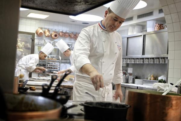 We're guessing microwavable, premade meals are <em>not</em> an issue in this kitchen, at the three-Michelin-star restaurant L'Auberge du Pont de Collonges near Lyon, France.