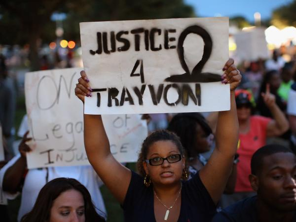 Supporters of Treyvon Martin wait in front of the Seminole County Criminal Justice Center before the not-guilty verdict was announced in the George Zimmerman murder trial on Saturday in Sanford, Fla. Now, the NAACP and other groups are calling for the Department of Justice to bring a civil rights case against George Zimmerman.