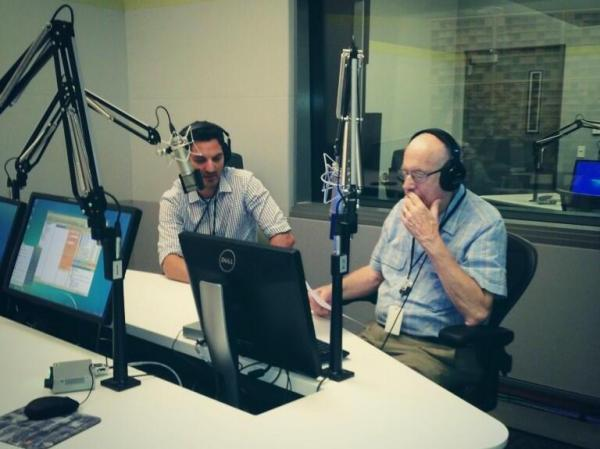 Guy Raz and Carl Kasell in the studio as Kasell reads LOLcat captions for <em>TED Radio Hour.</em>