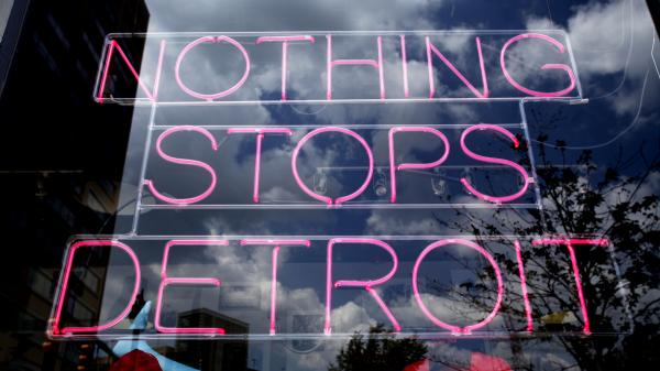 This Detroit store's neon sign sends a message.
