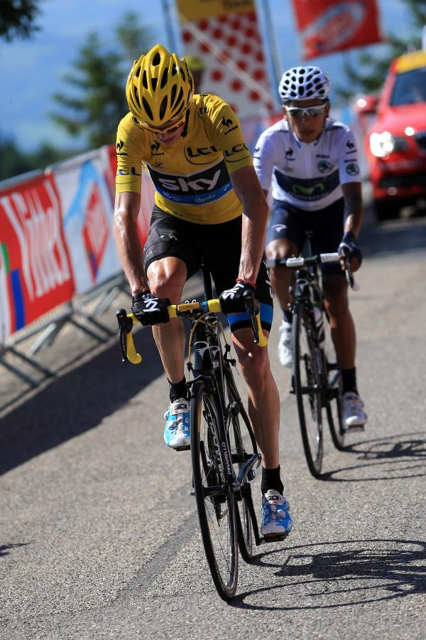 Yellow jersey winner Christopher Froome of Great Britain and second-place Nairo Quintana of Colombia raced neck and neck on the final climb during stage 20 of the 2013 Tour de France.
