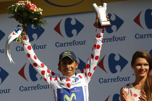 "Colombia's Nairo Quintana celebrates his polka dot jersey, which signifies he's the best climber. In addition to be ""King of the Mountains"" jersey, Quintana also bears the white jersey signifying the best young rider."