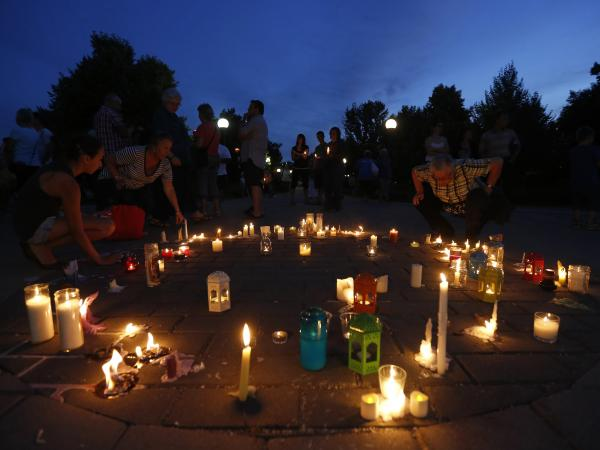 In Gatineau, Quebec, earlier this month, candles were burning in memory of the train disaster's victims.