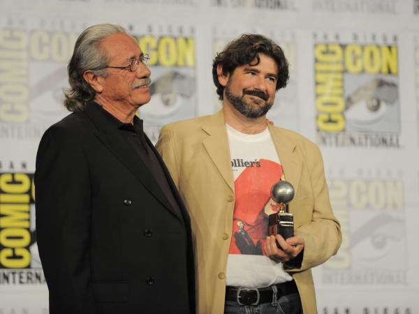 Actor Edward James Olmos (left) presents Juanjo Guarnido with an Eisner Award for his book <em>Blacksad: Silent Hell</em> on Friday.