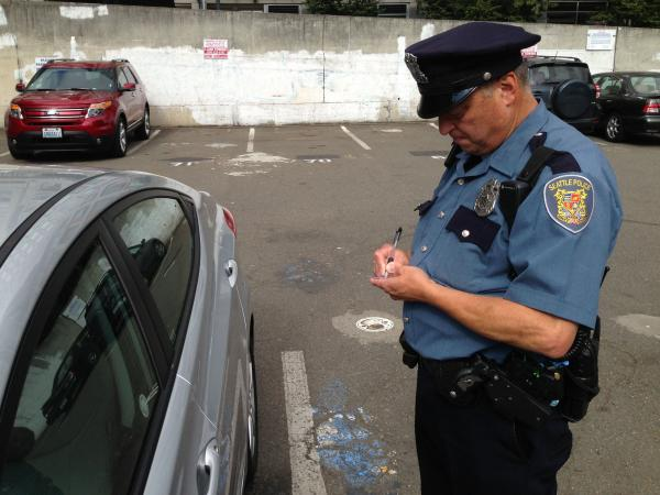 Seattle police officer Philip Monzon patrols an area where the department's predictive policing software has indicated car thefts are likely to occur.