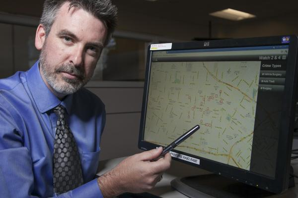 "Jeff Brantingham, creator of PredPol, demonstrates computer-generated ""predictive policing"" zones at the Los Angeles Police Department Unified Command Post in Los Angeles last year."