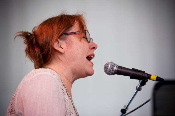 """Recently resurgent folksinger Iris Dement gives a gorgeous solo set. Spirit Family Reunion would join her on The Carter Family classic """"Keep on the Sunny Side."""""""