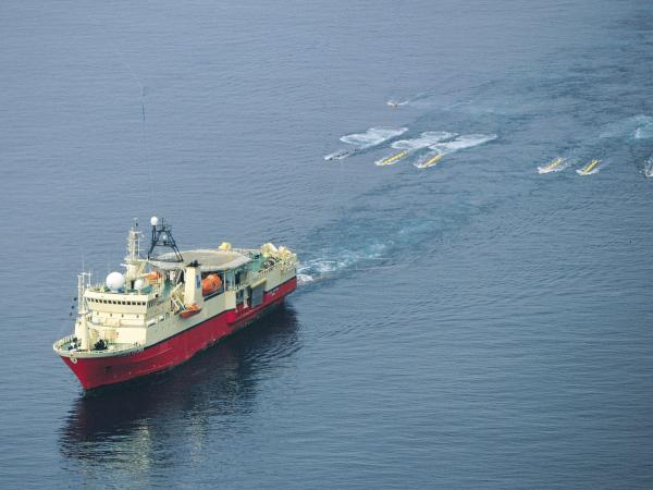 An industry vessel tows a seismic air gun array. The guns, which help with oil exploration, are one of the biggest culprits of underwater noise.