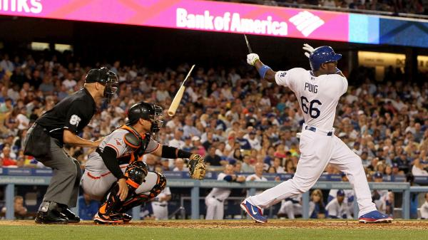 Yasiel Puig of the Los Angeles Dodgers breaks his bat on a single to right field during a game in June. The rate of such breaks has been cut in half since 2008.