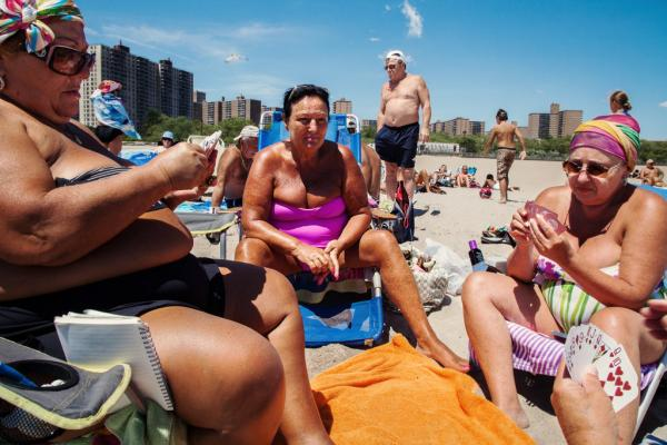 Ukrainian women from Odessa, Ukraine, play poker on the beach, June 2012.