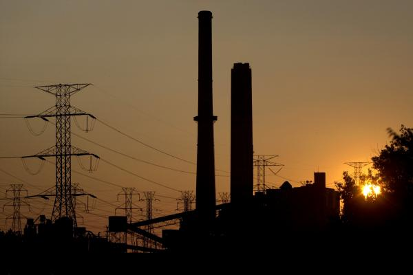 The sun sets behind the FirstEnergy Corp. power plant in Eastlake, Ohio. A software bug in a control room's alarm system prevented operators from realizing they had overloaded power lines. This caused a cascade of other problems that led to the massive blackout.